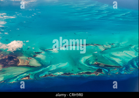 Aerial view of islands and clouds in the Bahamas. - Stock Photo
