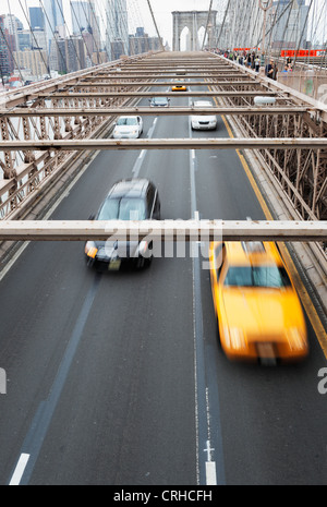 NEW YORK CITY, USA - JUNE 9: Cars driving on Brooklyn Bridge. June 9, 2012 in New York City, USA - Stock Photo