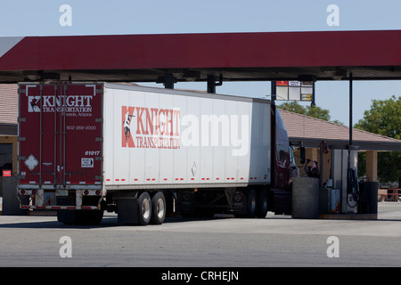 Tractor-trailer truck at a gas station - Stock Photo