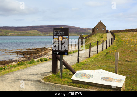 The Broch of Gurness tourist information sign by the entrance to Historic Scotland site at Evie, Orkney Islands, - Stock Photo