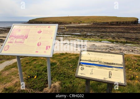 Tourist information signs about Brough of Birsay lighthouse and Norse settlement on tidal island. Orkney Islands, - Stock Photo