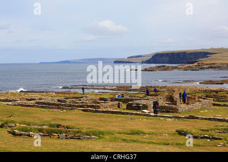 View to coast with remains of Pictish and Norse settlement excavated on the Brough of Birsay Orkney Islands Scotland - Stock Photo