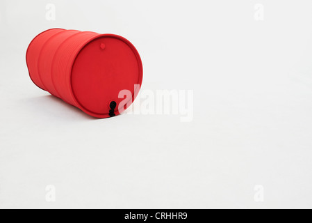 Metal oil drum lying on side - Stock Photo
