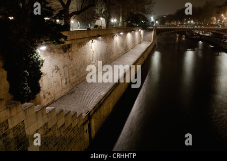 Seine river by night, Paris, France - Stock Photo
