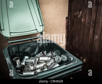 Aluminum cans in recycling bin - Stock Photo