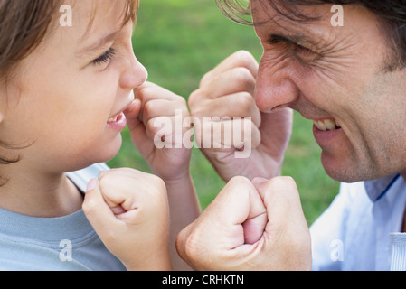 Father and son playfighting - Stock Photo