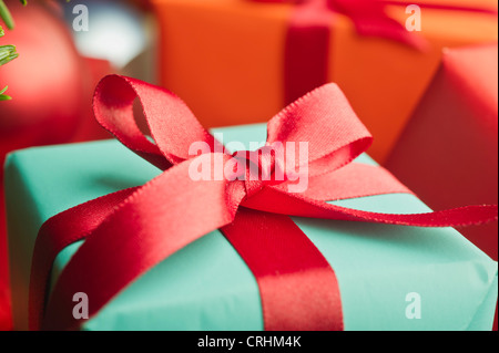 Festively wrapped Christmas gift, close-up - Stock Photo