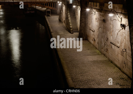 Bank of Seine river by night, Paris, France - Stock Photo