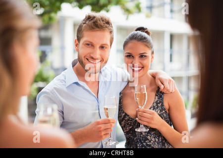 Couple drinking champagne together - Stock Photo