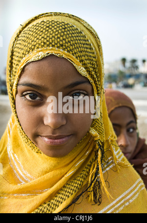 Young Muslim girl wearing colorful Hijab, Bandar-e Abbas, Iran - Stock Photo