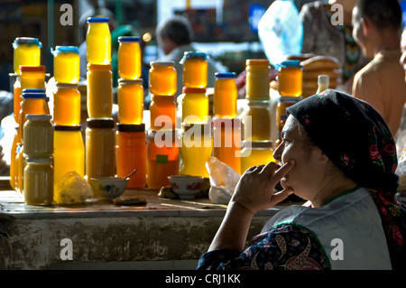 Honey vendor at the Tikinske Bazaar, Ashgabat, Turkmenistan - Stock Photo