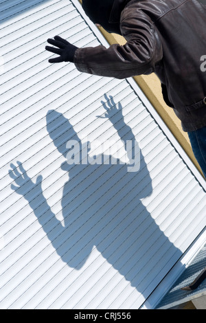 housebreaker caught red-handed holding the hands up - Stock Photo