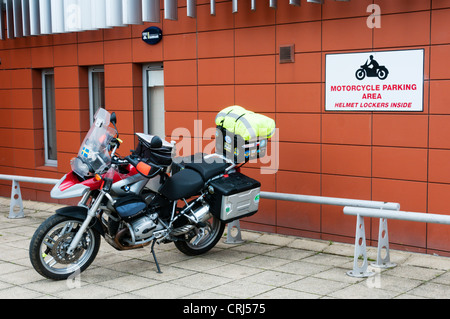 A motorbike parked in a designated area at a multi-storey car park. - Stock Photo