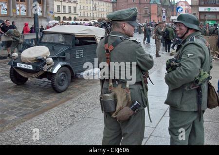 German troops re-enactors, Volkswagen Kübelwagen, shown after performing 1944 Warsaw Uprising re-enactment in Wrocław, - Stock Photo