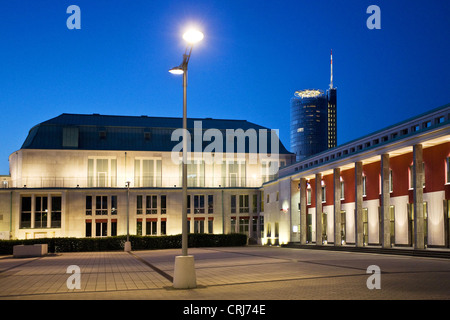 Saalbau of the philharmonics Essen, RWE tower in the background at blue hour, Germany, North Rhine-Westphalia, Ruhr - Stock Photo