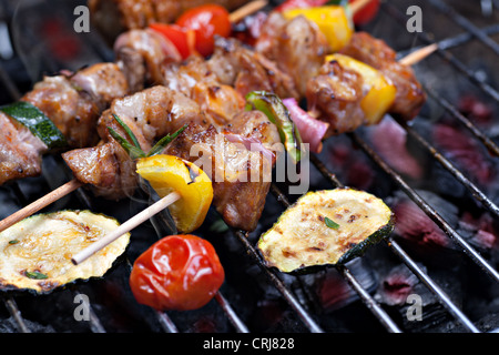 close up shut of a meat en brochette on the grill - Stock Photo