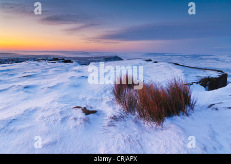 Snow early morning on Froggatt edge Derbyshire Peak District National park Calver England UK GB Europe - Stock Photo