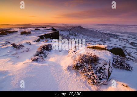 Winter Landscape Sunrise Snow  Froggatt edge Derbyshire Peak District National park Calver England UK GB Europe - Stock Photo