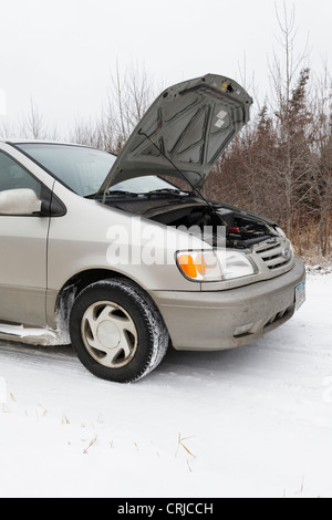 Vehicle on a rural road in winter with the hood up. - Stock Photo