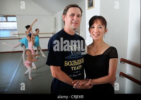 Ballet dancers and teachers Chika Temma and Yuri Demakov at their Bristol dance studio UK - Stock Photo