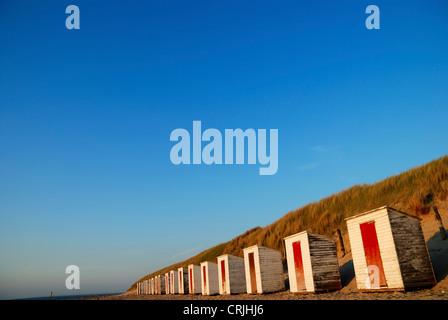 row of beach huts at sandy beach in front of dune, Netherlands, Zeeland, Cadzand - Stock Photo