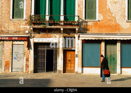 old man walking through the streets of Venice, Italy, Venice - Stock Photo
