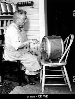 Homemaker making butter - Stock Photo