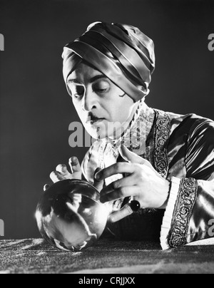 Fortune teller and crystal ball - Stock Photo