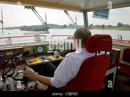 captain of a passenger ship on Rhine River, Germany, North Rhine-Westphalia, Ruhr Area, Duisburg - Stock Photo