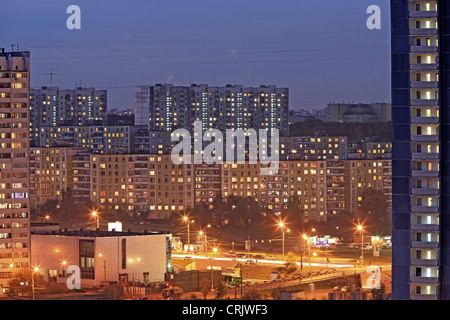 Apartment buildings in the evening with lights in windows, Russia, Moskau - Stock Photo