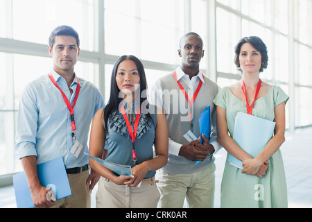 Business people wearing name tags - Stock Photo