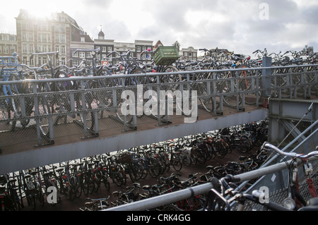 Bicycles parked on city sidewalk - Stock Photo
