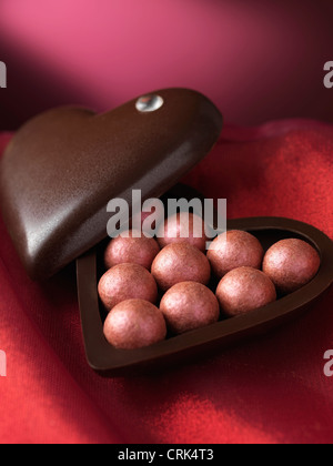 Close up of chocolates in decorative box - Stock Photo