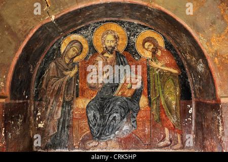 Peeling fresco of Jesus Christ on a wall at the Great Lavra Monastery, Mount Athos, Greece. - Stock Photo