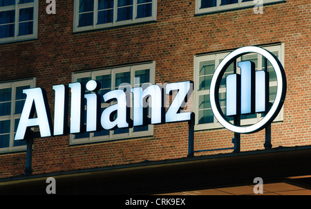 Logo Allianz AG to Treptowers in Berlin at night - Stock Photo