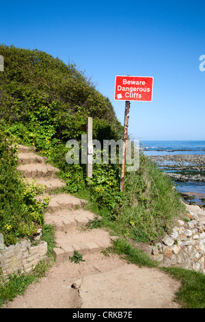 Beware Dangerous Cliffs Sign on the Cleveland Way at Scalby Mills Scarborough North Yorkshire England - Stock Photo