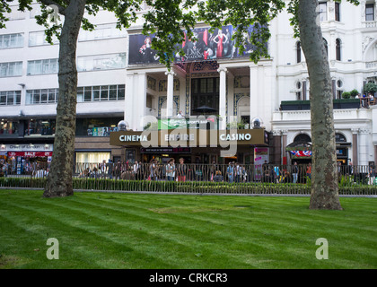 The Empire Cinema from Leicester Square Gardens just after the gardens were refurbished in 2012 - Stock Photo