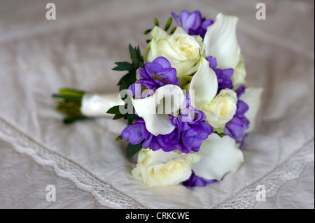 wedding bouquet of freesia, lilies and roses in white and purple - Stock Photo