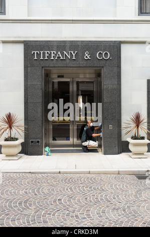 The windows and doors of Tiffany and Co Jewelers on Rodeo Drive, Beverly Hills being cleaned - Stock Photo