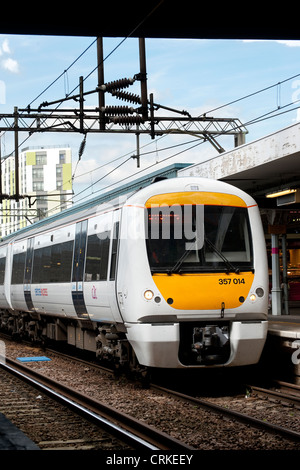 Passenger train in National Express c2c livery waiting at a railway station in England. - Stock Photo