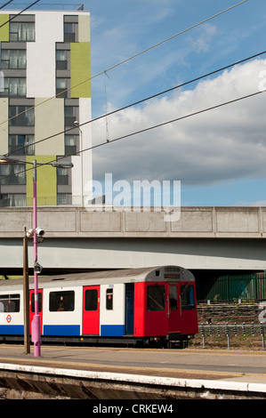 London Underground train waiting at a railway station in London, England. - Stock Photo