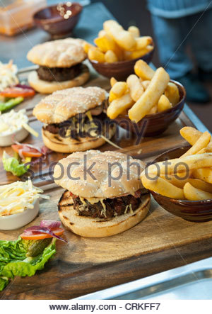 Plates of burgers and french fries - Stock Photo