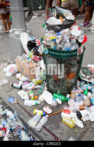 overflowing trash can, New York - Stock Photo