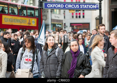 Passengers queeuing to get into Oxford Circus tube station that has been temporarily closed due to the high volume - Stock Photo