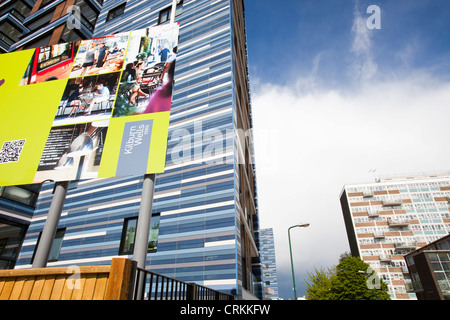 Contrast between old social high rise flats and new apartments in Queens Park, London, UK. - Stock Photo