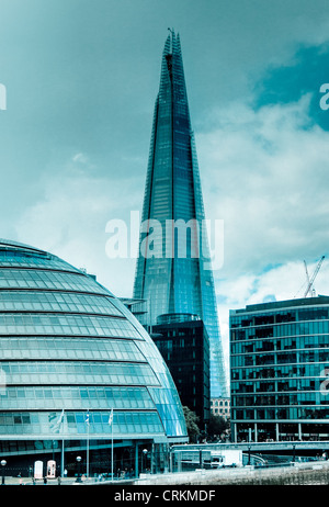 The Shard and London City Hall on the South Bank of the River Thames with a silver/blue hue to the image - Stock Photo