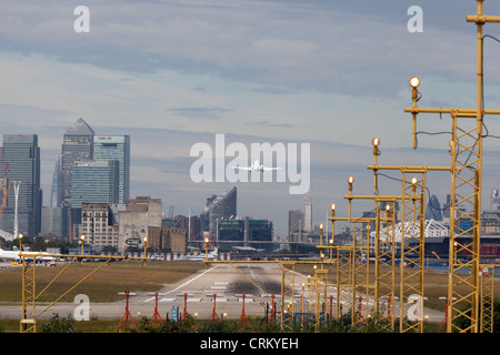 Jet taking off London City Airport - Stock Photo