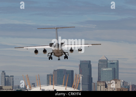Jet landing at London City Airport - Stock Photo