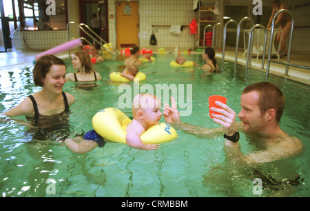 Mother and child in baby swimming, Berlin - Stock Photo