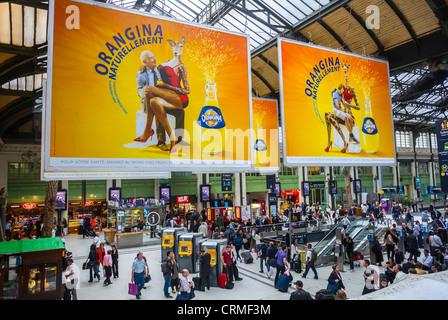 Paris, France, French Soft drink Advertising Billboards in Train Station, 'Gare de Lyon', Orangina (Coca Cola) - Stock Photo